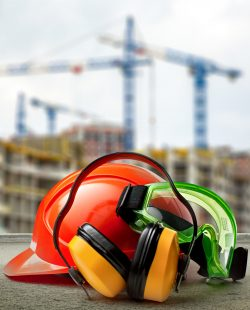 Red helmet and earphones on buildings background closeup